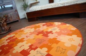 Detský guľatý koberec PUZZLE oranžový