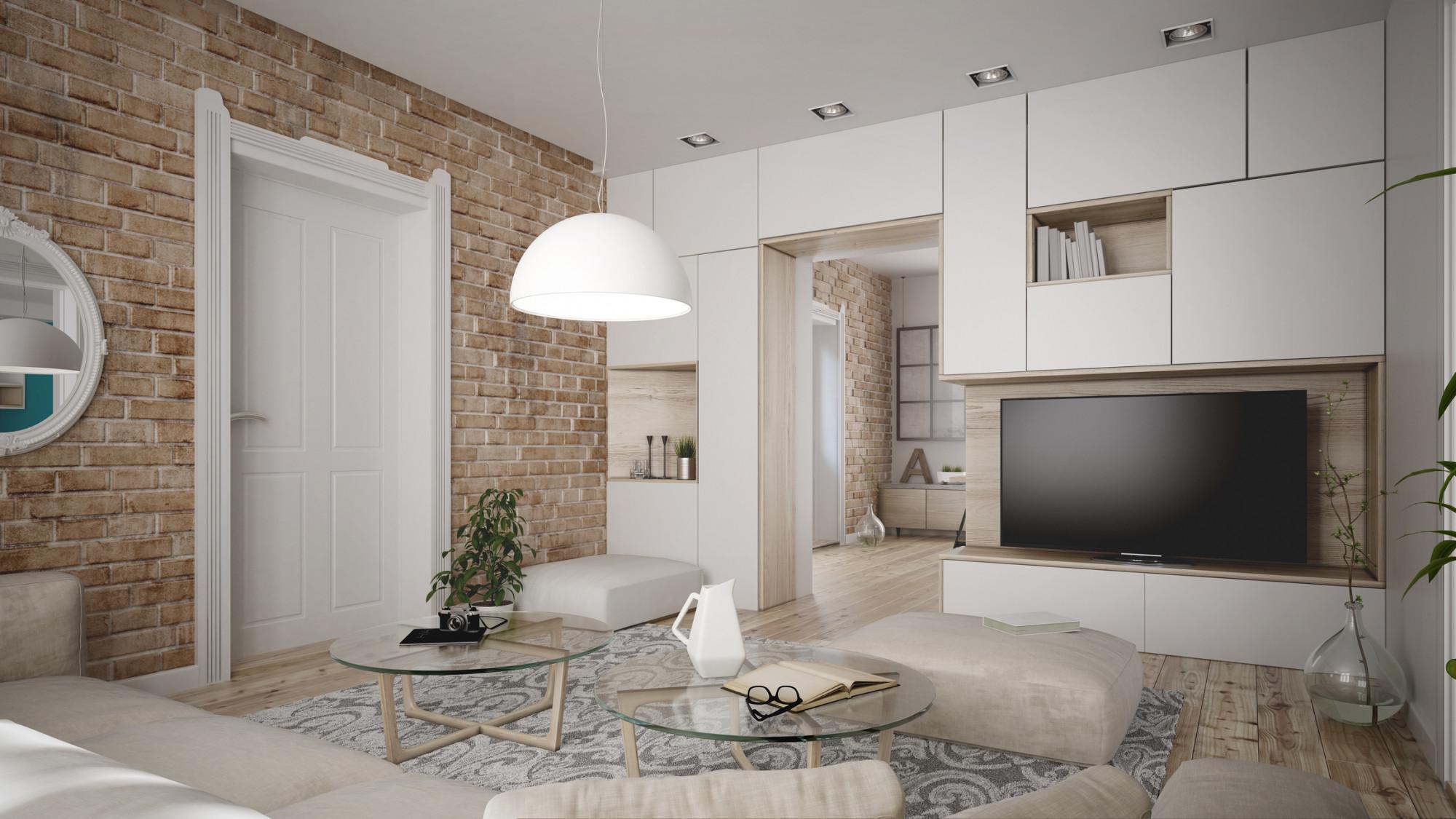 Biely nábytok v modernej obývačke so štýlovou tehlovou stenou
