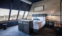 Industriálny interiér s americkou boxspring posteľou