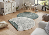 Moderný okrúhly obojstranný koberec do obývačky