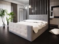 Spálňa so sivou manželskou čalúnenou posteľou