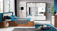 Moderná spálňa presvetlená bielym nábytkom