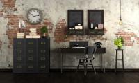 Tmavý písací stôl a komoda v industriálnej pracovni
