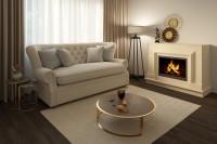 Elegantná pohovka v luxusnej obývačke s krbom