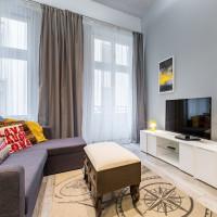 Rohová sedačka a industriálny stolík v modernej obývačke