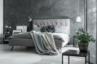 Čalúnená posteľ v modernej sivej spálni