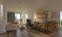 Rohová sedačka v modernej obývačke s kuchyňou