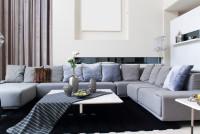 Sivá sedačka do U v modernej obývačke