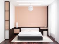 Manželská posteľ v elegantnej spálni s ružovou stenou