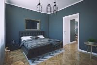 Čalúnená manželská posteľ v klasickej tmavosivej spálni