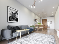 Sivá pohovka v úzkej škandinávskej obývačke