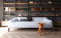Dizajnová biela pohovka v modernej obývačke