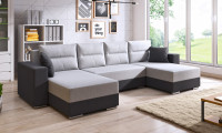 Moderná obývačka so sivou rozkladacou sedačkou
