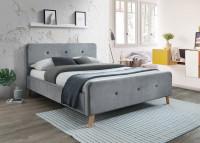 Retro spálňa so sivou čalúnenou posteľou