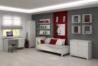 Študentská izba s bielym nábytkom a červenými doplnkami