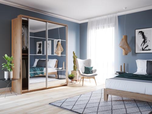 Modrá spálňa s moderným nábytkom
